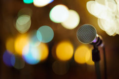 Bokeh microphone. Mic on colorful blurred bokeh background royalty free stock photography