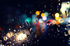 Bokeh night. From the rain and water Stock Photography