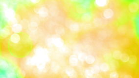 Bokeh Particles on a Yellow Background stock video footage