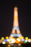 Bokeh photo of Eiffel Tower at night in Paris Stock Images