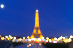 Bokeh photo of Eiffel Tower at night in Paris Stock Photo