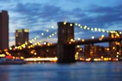 Bokeh photo of New York City Brooklyn Bridge at night Royalty Free Stock Photo