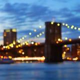 Bokeh photo of New York City Brooklyn Bridge at night Stock Photography