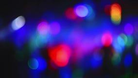 Bokeh que destella multicolor borroso de luces del estrobosc?pico almacen de metraje de vídeo