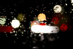 A Bokeh rain night day with raindrops Stock Image