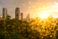 Bokeh of raindrop on glass with building background at sunset Stock Photo