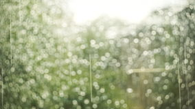 Bokeh of Raindrops on a window in the summer stock footage