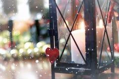 Bokeh retro de la nieve de la forma del corazón Imagenes de archivo