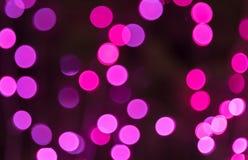 Bokeh rosado el noche, para el fondo de la Navidad Fotografía de archivo libre de regalías