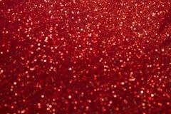 Bokeh rosso astratto circonda per il fondo di Natale, lig di scintillio Fotografia Stock Libera da Diritti