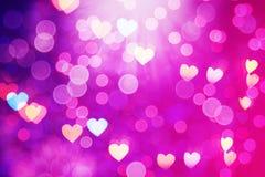 Bokeh roze purpere harten als achtergrond, cirkels Stock Afbeeldingen