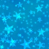 Bokeh seamless shinning background five-pointed stars in different sizes irregularly scattered on blue background Stock Photos