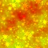 Bokeh seamless shinning background yellow stars in different sizes irregularly scattered on orange mottled  background Royalty Free Stock Photography