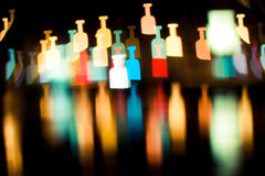 Bokeh series - bottles royalty free stock photography
