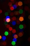 Bokeh of several Christmas lights. Against a dark background Stock Image