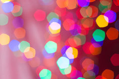Bokeh of several Christmas lights. Against a light background Royalty Free Stock Image