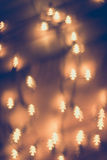 Bokeh shaped pines, golden lamp. During Christmas Royalty Free Stock Photography