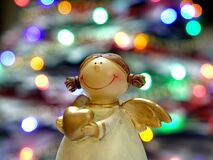 Bokeh Shot of White and Gold Ceramic Angel Royalty Free Stock Photo