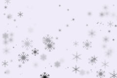 Bokeh snöflingor och vit bakgrund Royaltyfria Foton