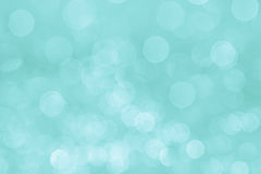 Bokeh soft pastel aqua background with blurred white lights. Stock Image