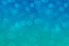 Bokeh soft pastel aqua and blue background with blurred rainbow lights. Royalty Free Stock Images