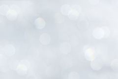Bokeh soft pastel white background with blurred rainbow lights. Royalty Free Stock Photo