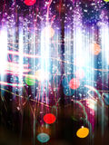 Bokeh and Sparkles. Bright background with colorful sparks and bokeh effect Royalty Free Stock Photography