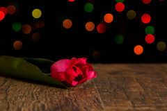 Bokeh spots of lights with flower on wood Royalty Free Stock Image