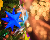 Bokeh. Star and Christmas Tree Light in Action Royalty Free Stock Image