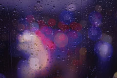 Bokeh street traffic lights Rainy day Royalty Free Stock Images
