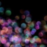 Bokeh suddiga ljus på mörk bakgrund 10 eps Arkivfoto