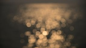 Bokeh of sunset light reflect on sea wave (Blurred background) stock video