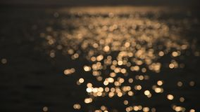Bokeh of sunset light reflect on sea wave (Blurred background) stock footage