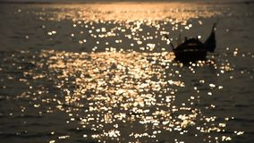 Bokeh of sunset light reflect on wave  (Blurred to focus background) stock footage