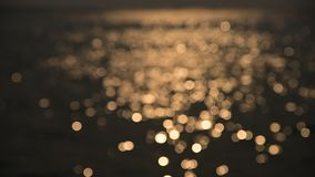 Bokeh of sunset light reflect on wave  (Blurred to focus background) stock video footage