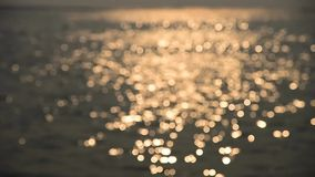 Bokeh of sunset light reflect on wave (focus to blurred background) stock video