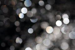 Bokeh sur le noir Photographie stock libre de droits