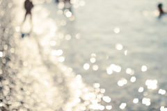 Bokeh tło, morze, plaża, słońce Obraz Royalty Free