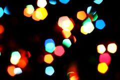 Bokeh texture garland blur. New year colorful rainbow lights Stock Photos
