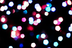 Bokeh texture garland. New year colorful rainbow lights blur Stock Photography