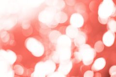 Bokeh toned in Living Coral color. Color of the year 2019 stock image