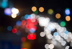 Bokeh traffic light in city at night Stock Images