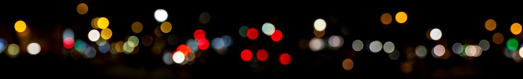 Bokeh traffic light at night in the street of a big city Royalty Free Stock Images