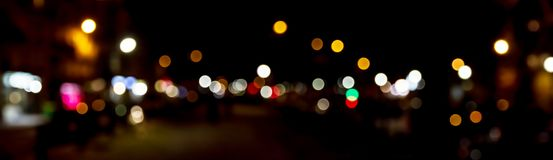 Bokeh traffic light at night in the street of a big city Royalty Free Stock Photo