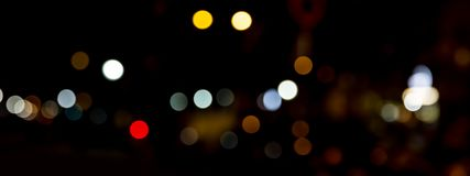 Bokeh traffic light at night in the street of a big city Royalty Free Stock Photography