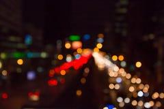 Bokeh urbain abstrait de lumière de nuit de ville, fond defocused images stock