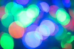 Bokeh Vage achtergrond Feestelijke gekleurde lichten royalty-vrije stock afbeeldingen