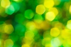 Bokeh verde y amarillo del día de fiesta Imágenes de archivo libres de regalías