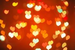 Bokeh vermelho do coração como o fundo Imagens de Stock