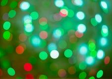 Bokeh vermelho e verde do feriado Fundo abstrato do Natal Fotos de Stock Royalty Free